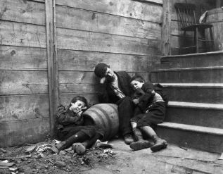 Three Children Sleeping in a Dirty Alley